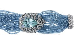 Cartier collection bracelet in platinum with pear-shaped aquamarine, aquamarine beads, engraved moonstones, one Tahitian pearl and brilliant-cut diamonds.  Photo c/o The Jewellery Editor