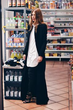 COAT: DIMITRI . SHIRT: REPRESENT CLOTHING . PANTS: DIMITRI . SHOES: CASADEI