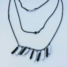 Check out this item in my Etsy shop https://www.etsy.com/listing/514410602/gunmetal-black-chain-multi-row-choker