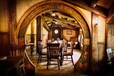 Hobbit Dining Room with a Long Table. A doorway like this looks awesome in earthbag and cob homes.