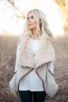 This one is gorgeous! I'm obsessed with these Shearling Vests. They are an absolute must have for Fall and Winter! This vest features a flowy fit, front pockets and faux leather piping! Small fits siz