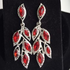Rhinestone and red stone pierced earrings These beautiful sparklers dance in the light and will enhance any outfit!!! They have never been worn and are NIB. Jewelry Earrings