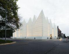 http://www.ignant.de/2015/06/08/the-tip-of-an-iceberg-the-szczecin-philharmonic-hall/
