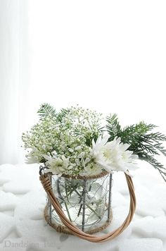 White floral arrangement with greenery lends a soft and fresh alternative to Christmas via dandelionpatina.com #cottagestyle