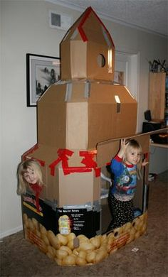 "Cardboard rocket ship.  Check link for finished project and for ""control panel"" inside - awesome! Kind of looks like a castle too"