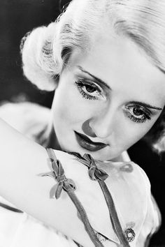"""When a man gives his opinion, he's a man. When a woman gives her opinion, she's a bitch.""  – Bette Davis"