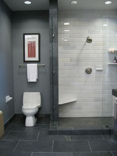 This is different than what we've been looking at, but its nice and masculine... black slate floor white stone subway tile in shower blue gray walls shower surround frameless glass shower Kirsty Froelich Bathroom -- master bath. I was just describing this to my hubs from my imagination...