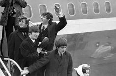 The Beatles make a windswept arrival at JFK airport in New York City on Feb. 7, 1964.