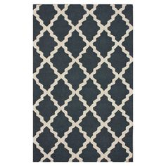 Wool rug in charcoal with a trellis motif. Hand-hooked in India.   Product: RugConstruction Material: 100% Wool