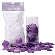 Inexpensive Wedding Decor Idea:: buy white rose petals from the Dollar Tree (300 petals for $1.00) and dye them any color with fabric dye fo...