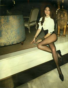 high waist, stockings, white blouse. some goldish jewlery, but not too bling. chloe lecareux