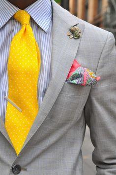 Men's Grey Vertical Striped Dress Shirt, Yellow Polka Dot Tie, Pink Paisley  Silk Pocket Square, Grey Blazer, and Gold Lapel Pin