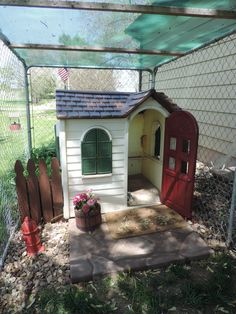 Play house turned dog house.  Someone was throwing away this child's playhouse, so I confiscated it and turned it into a cute little dog house. I used an old platform that usually goes underneath air conditioners for the front porch.  I painted it to look like flagstone. I salvaged the cement fire hydrant, and with a little work it looks good again. I made the cedar barrel out of old fence wood that I got for free.  A very nice look for very little money.