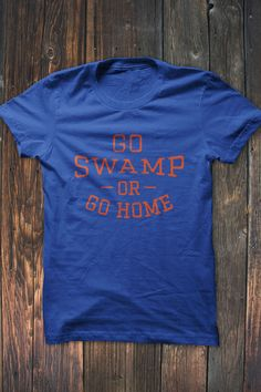 Florida Fans, Show off your school pride in this Go Swam or Go Home T-Shirt. Available in orange distressed print on deep blue t-shirt. Our shirts are printed on Bella + Canvas shirts. #bourbonandboots