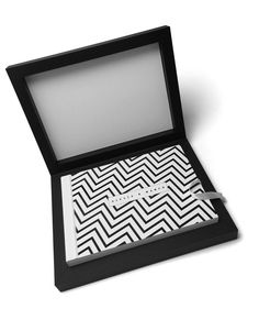 The box - made with the classic black touch material - is finished with black raised varnishing checked motif, and the cover features an eye-catching black and white #zigzag effect. The peculiarity of this book lies in the photographer's aesthetic choice to recall textures and colours of the bride and grooms' attire.