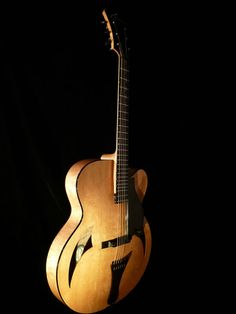 http://marchione.com/instruments/18-archtop/