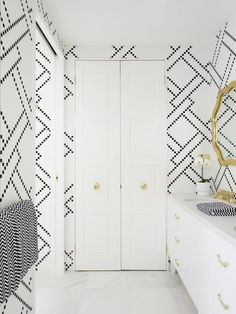 Who Makes This Cool Black & White Wallpaper? — Good Questions -- someone said that it was tiny octogonal tiles.