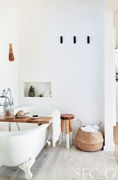 The bathroom tub is Randolph Morris; the dip-dyed stool is from Serena & Lily.
