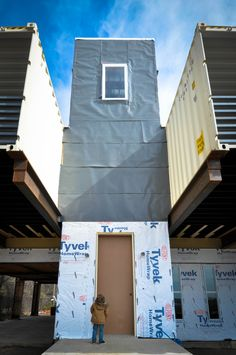 Entry with temporary front door. The grey wrap above the Tyvek is an Ice & Water shield.
