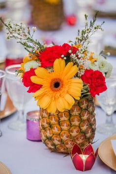 Pineapples make the best themed centerpieces for a reasonable price!