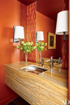 inset mirror with flanking tile The powder room in a Manhattan apartment by designer Bruce Bierman features a vanity made of Macaubas Gold quartzite. Architectural Digest, Spas, Manhattan Apartment, York Apartment, Apartment Renovation, Orange Walls, Orange Rooms, Bathroom Interior Design, Beautiful Bathrooms