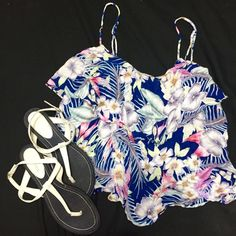 AE floral camisole with Ruffle Good condition. Kind of short but could be used as a crop top or worn with high waisted shorts :).  sandals shown will be in a separate listing. I also have bundle discounts ;) American Eagle Outfitters Tops Camisoles