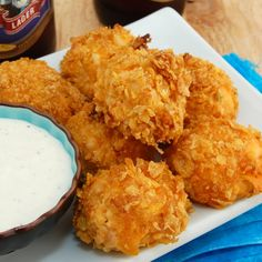 {Baked Buffalo Chicken Bites}... Combine 3 c shredded cooked chicken, 1/2 c buffalo sauce, 3.5 oz cream cheese, 1.75 c cheddar, & 1/4 c chopped green onion... Roll chicken mixture into 1.5 in balls... Roll each ball in flour, egg, then crushed cornflakes... 350/25 mins/lined with parchment paper