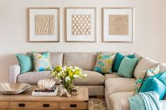 Love how the splash of turquoise lifts the cushions from the lounge colour. House of Turquoise: Highgate House
