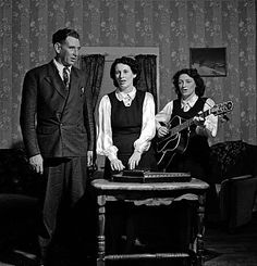 """The Carter Family. The lady with the guitar is Mother Maybelle, the other woman is her cousin Sara, and the man is Sara's husband, A.P. Carter. Maybelle was June Carter's mom, so Johnny Cash's mother-in-law. There is a wonderful documentary about the Carter Family called """"The Winding Stream"""". (Thank you Eliza Hunter for the information! Rhian)"""