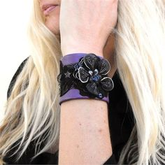A purple leather cuff statement bracelet with beaded floral trim, perfectly feminine goth!Created from soft and supple garment leather fora 5.5 wrist,2 wide. Very easy to wear, fastens with two snaps. (Model Demaris wrist is 5.5)   Hand-made, one-of-a-kind.    Materials:leather, floral trim and applique, thread, metal snaps