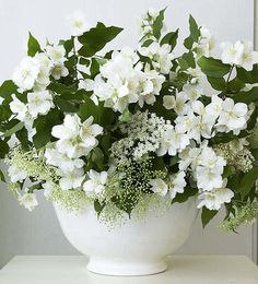 White flowers with greenery