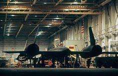 black plane in hanger