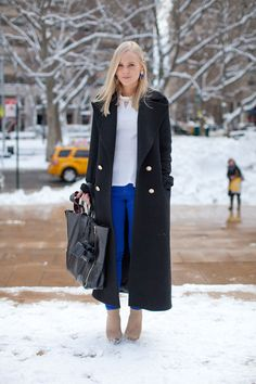 A long coat gives just the right amount of elegance to whatever is underneath it. Street Style Fall 2013 - New York Fashion Week Street Style - Harper's BAZAAR