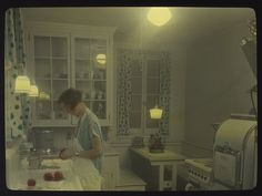 Woman in kitchen, circa 1930s | Item 78065, City Light Glass… | Flickr