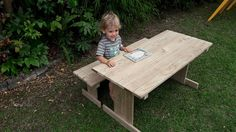 Toddler sitting at a picnic table