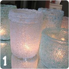 Mason jars rolled in epson salt. Can spray paint the jar first for a more snowy effect.