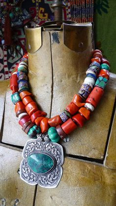 Necklace | Helena Nelson-Reed.  Silver and turquoise Indian pendant is combined with coral, vintage Venetian trade beads, bauxite, conch shells, inlaid yak bone beads, four sided turquoise mosaic beads from either Nepal