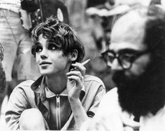 Edie with cig with (looks like) allen ginsberg