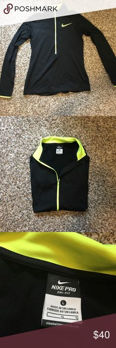 Nike Pro Dri-Fit 1/2 zip up. Large. Barely worn Large. Black and neon yellow Nike Pro Dri-Fit zip up. Long sleeve with thumb holes. Nike Tops