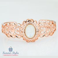 Imagine walking along the beach with the sand between your toes and this stunning pearl cuff bracelet on your wrist. Welcome to paradise! || Timna Jewelry Collection™ Oval Cabochon White Mother Of Pearl Copper Cuff Bracelet [Promotional Pin]