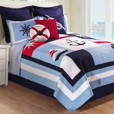 Accent Pillows Add a nautical flair to your bedroom with the Noah Reversible Quilt. Decked out in a red, white and blue color block pattern with sailing motifs, the whimsical bedding is the perfect complement to your seaside escape. Anchor Bedding, Nautical Bedding Sets, Beach Bedding Sets, Navy Bedding, Nautical Bedroom, Matching Bedding And Curtains, Nautical Home, Quilt Bedding, Comforter Sets
