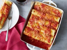@kelseynixon rolls homemade sheets of pasta to make these sausage cannelloni in  simple red sauce.