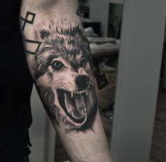 Freshly done, black and gray wolf with blue eyes on mans hand. Artist John Logan. #wolf #wolftattoo #animal #animaltattoo #roar #roaringwolf #blackandgray #blackngray #armtattoo #manwithtattoos #wildlife #nature #riga #tattooinriga #tattooed #art #tattooink  #ink #inked #skin #tattooartist #tattoofrequency #share #like #follow