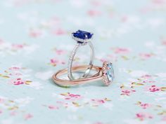 No one can ever say no to these... Aquamarine and tanzanite rings with diamond accents in rose and white gold.