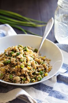 This is the best 10 Minute Veggie Fried Rice! Made with brown rice, frozen corn and peas, creamy eggs, fresh herbs, garlic, and ginger. 300 calories.