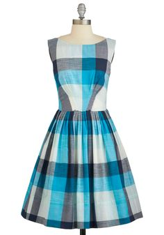 This knife-pleated frock dreamily mixes shades of aqua, cerulean, white, and pale-blue.