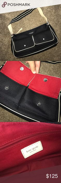 Kate Spade purse Great condition! Black color. Red interior. Such a cute small over the shoulder bag! Zips shut and has a zipper compartment inside. kate spade Bags Mini Bags