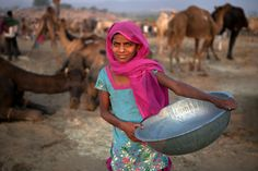 https://flic.kr/p/wAWk1Q | Muskan. Pushkar, India | Muskan, a young beautiful green-eyed girl from a village near Ajmer has come for collecting camel dung as combustible at the Pushkar fair in Rajasthan, India.