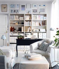 desk position (in front of shelves), art placement, chairs, etc. black desk white shelves