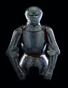 A COMPOSITE SOUTH GERMAN FLUTED HALF-ARMOUR FOR FIELD USE IN THE SO-CALLED 'MAXIMILIAN' FASHION, CIRCA 1510-20.